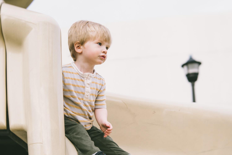 Boy on slide | Francesca Russell Photography & Films | Garden City Family Photographer