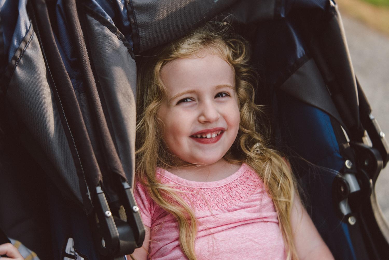 Girl in stroller | Francesca Russell Photography & Films | Garden City Family Photographer
