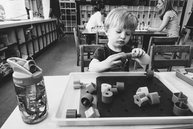 Logan playing with blocks.