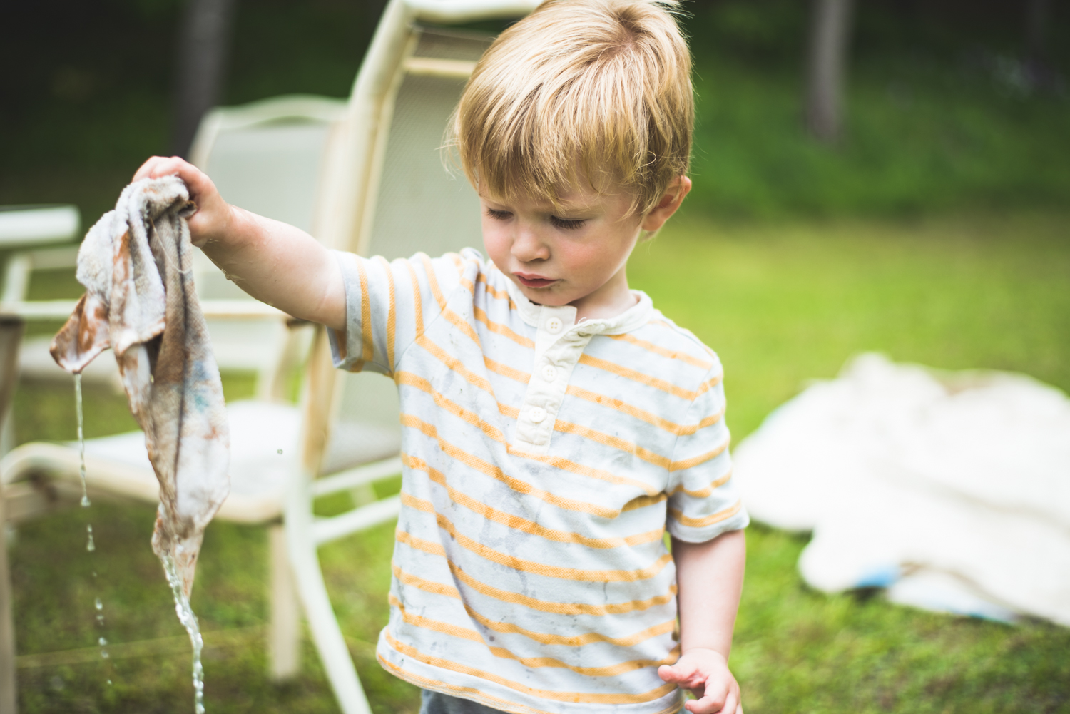 Boy playing with wet rag | Francesca Russell Photography | Nassau County Family Photographer