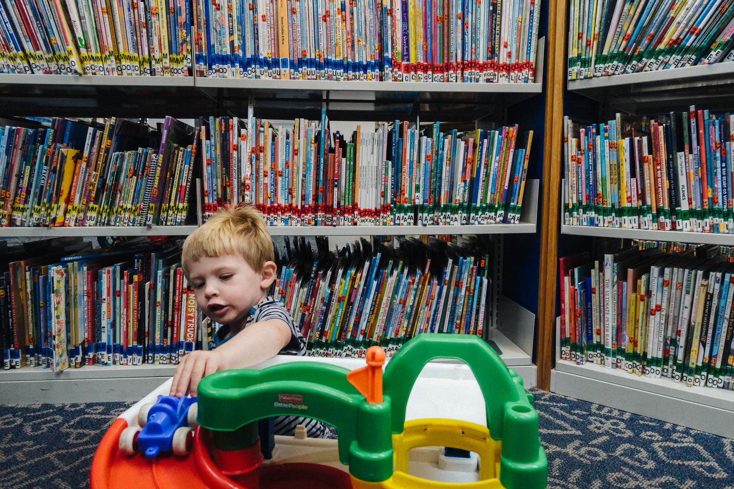 Francesca Russell Photography | Long Island Family Documentary Photography | Boy at the library