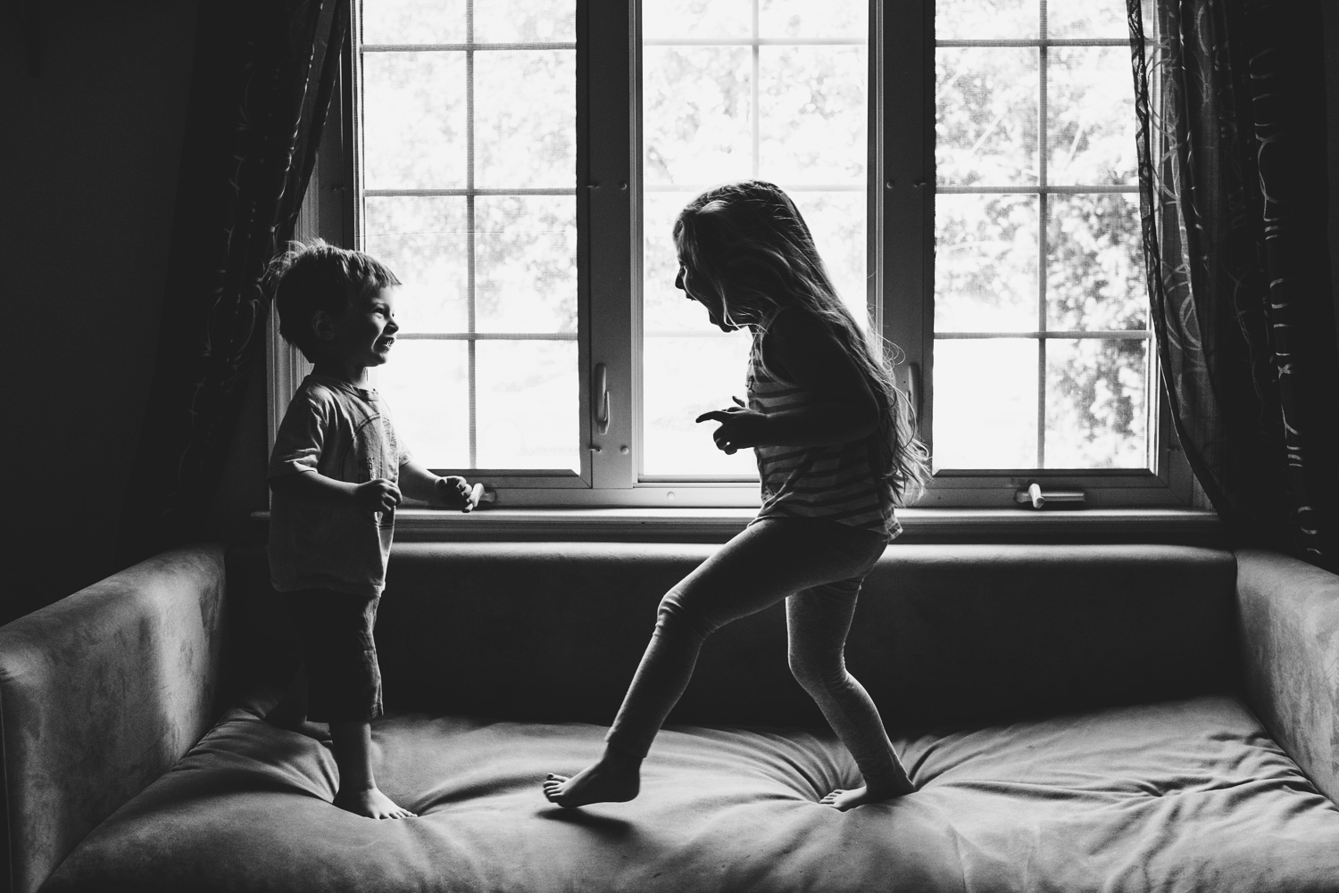 Francesca Russell Photography | Long Island Family Documentary Photography | Brother and sister jumping on the couch