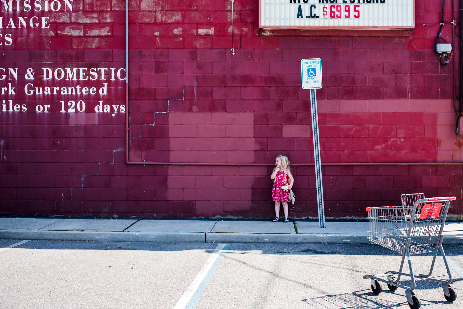 Francesca Russell Photography | Long Island Family Documentary Photography | Lila in a parking lot
