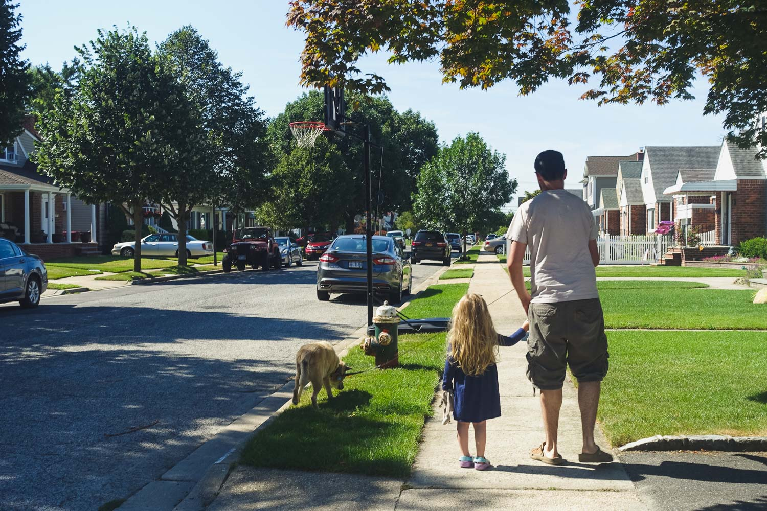 Francesca Russell Photography | Long Island Storytelling Photographer | Lila walking with Eric and Riley