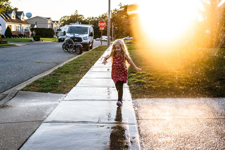 Francesca Russell Photography | Long Island Storytelling Photographer | Lila running through the sprinkler