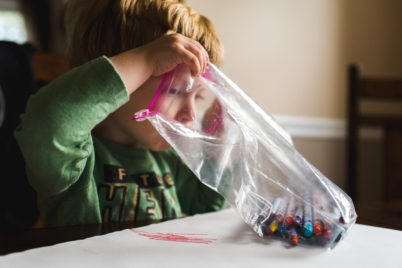 Little boy coloring.