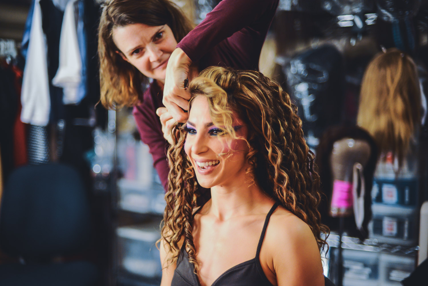 """Cassie Silva getting wigged backstage on """"Rock of Ages""""."""