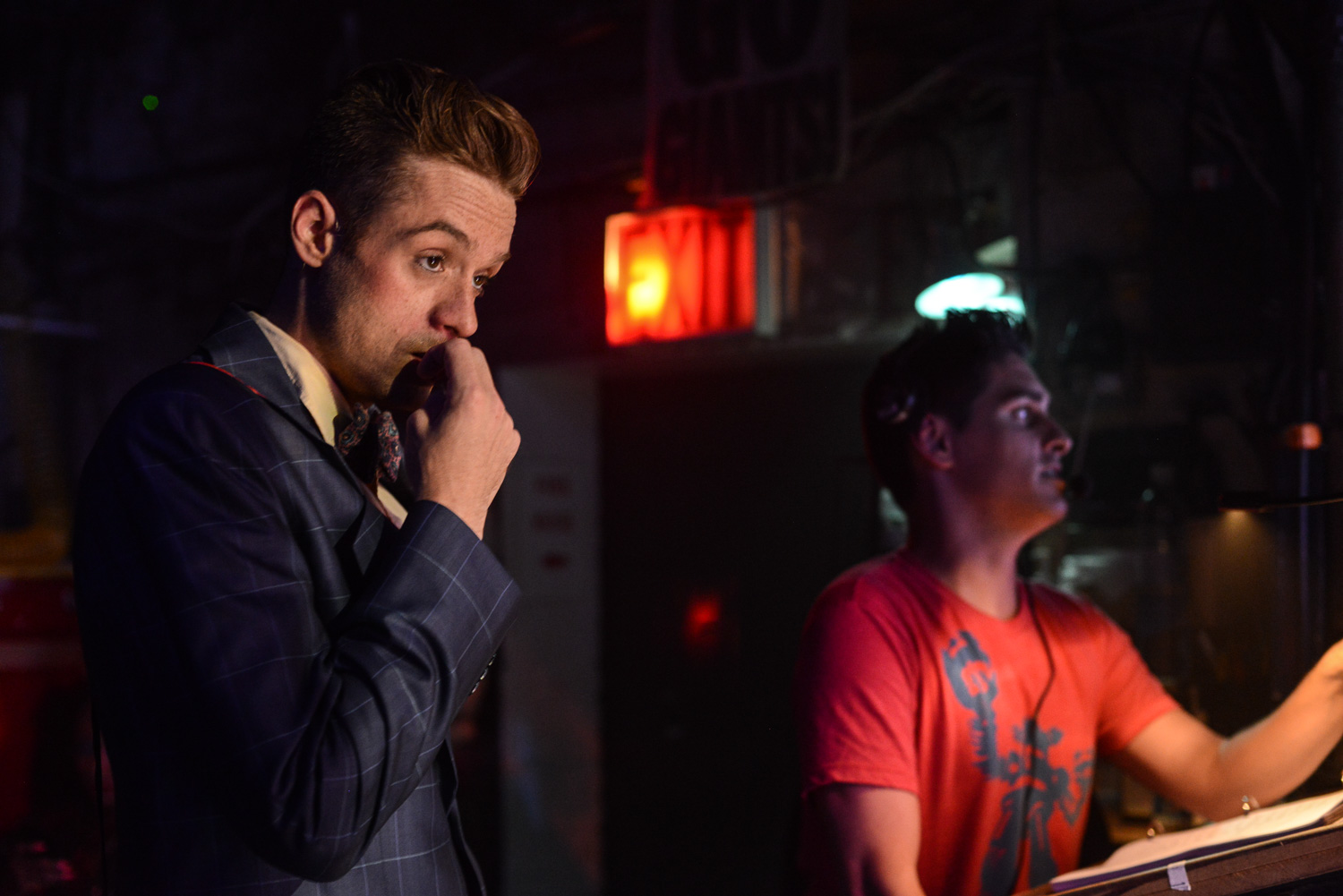 """Cody Lancaster waiting in the wings at """"Rock of Ages"""", while Justin Scribner calls the show."""