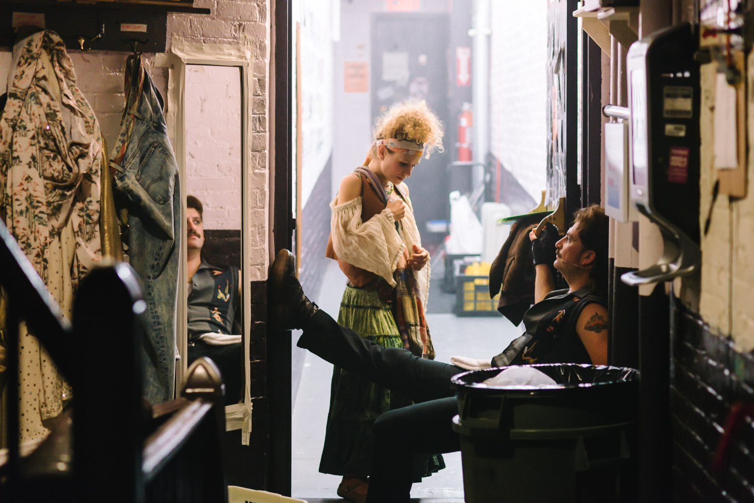 """Josephine Rose Roberts and Genson Blimline relaxing between scenes at """"Rock of Ages""""."""