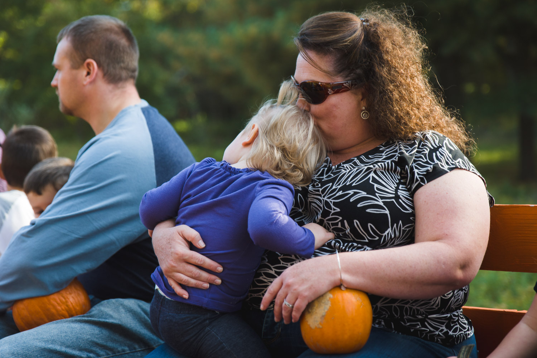 Mother kissing toddler daughter.