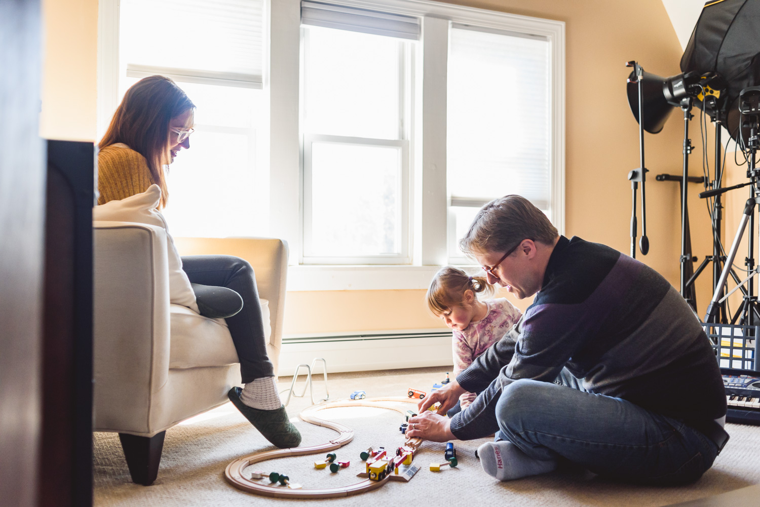 Family playing with a train set.