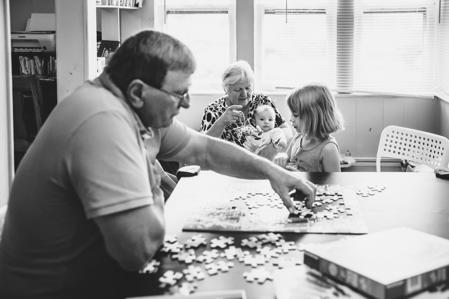 Family working on a puzzle.