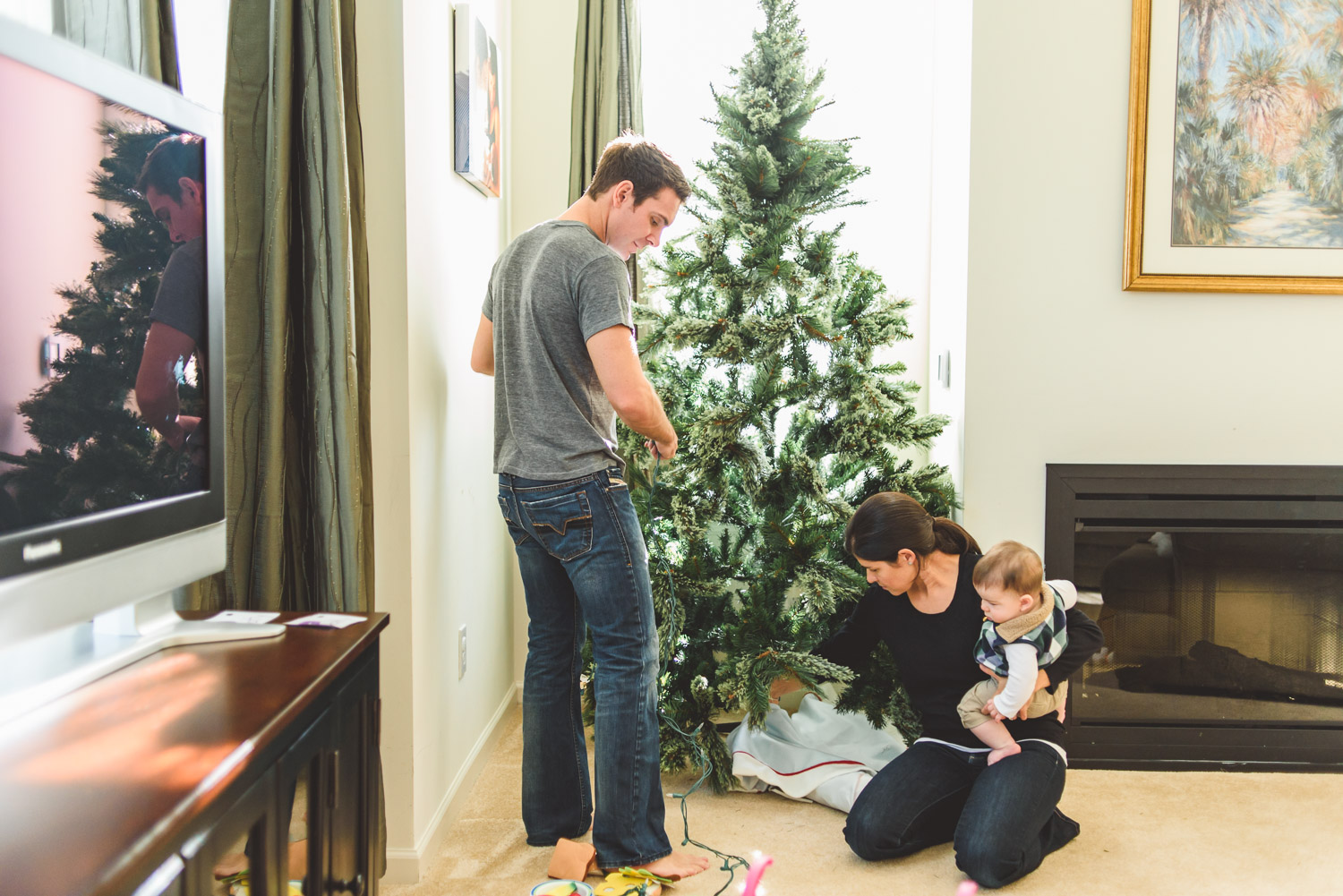 Family decorating a Christmas tree.