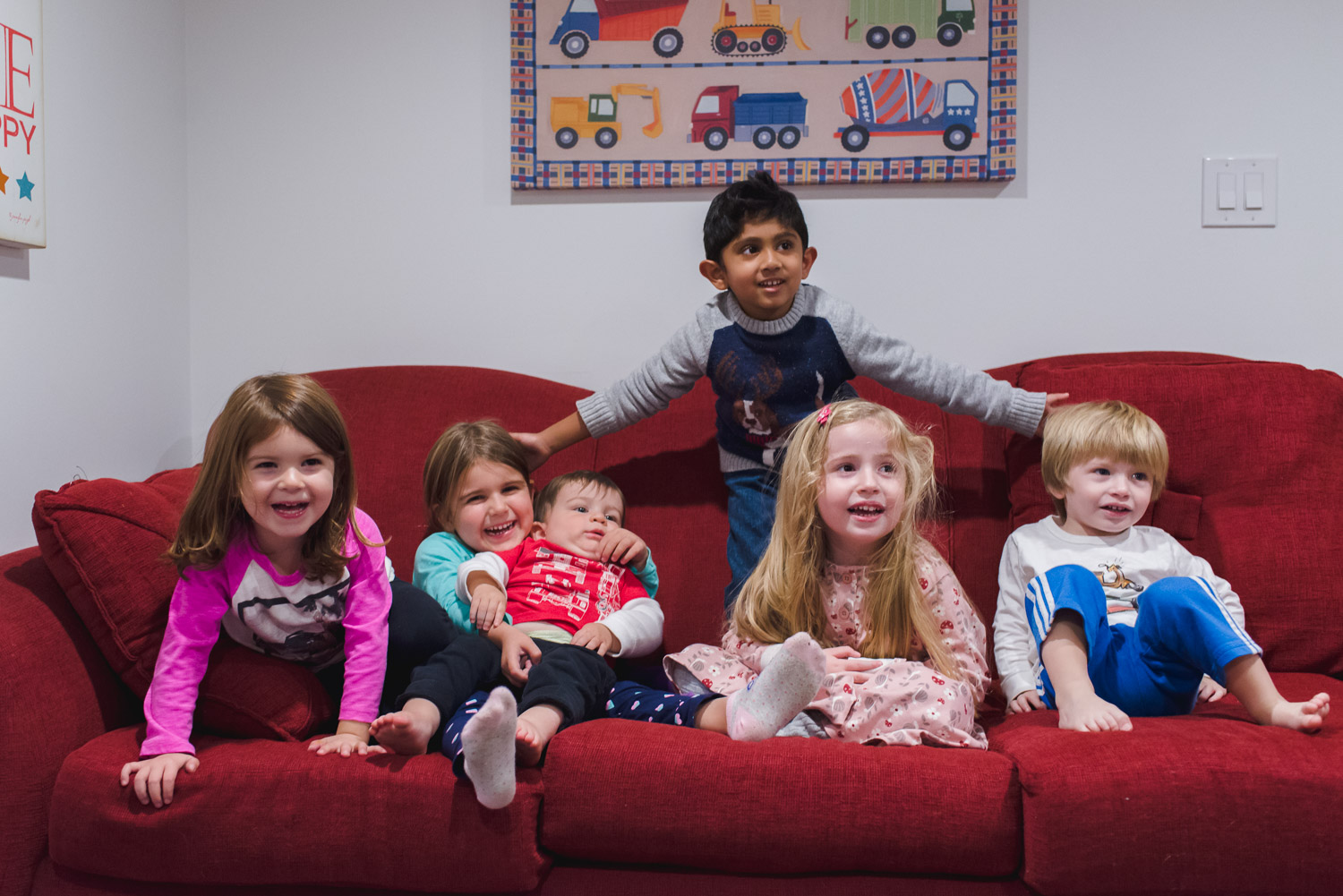 Kids gathered on the couch.