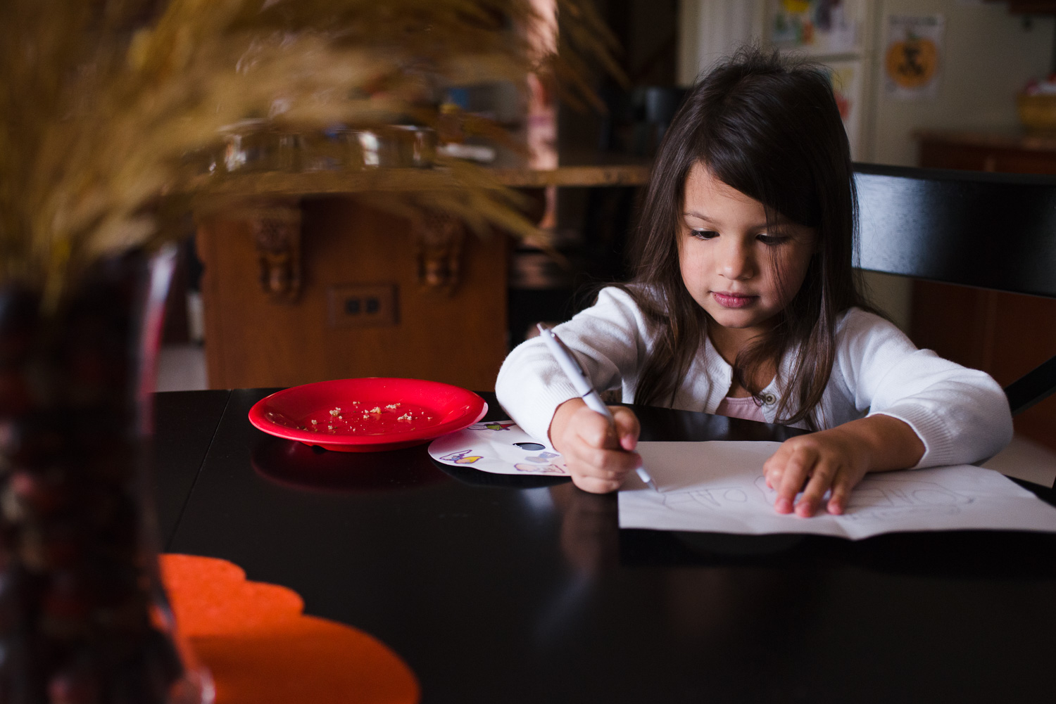 Little girl drawing a picture.