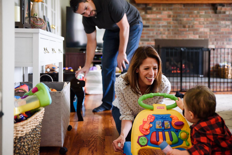 Parents laughing at toddler.