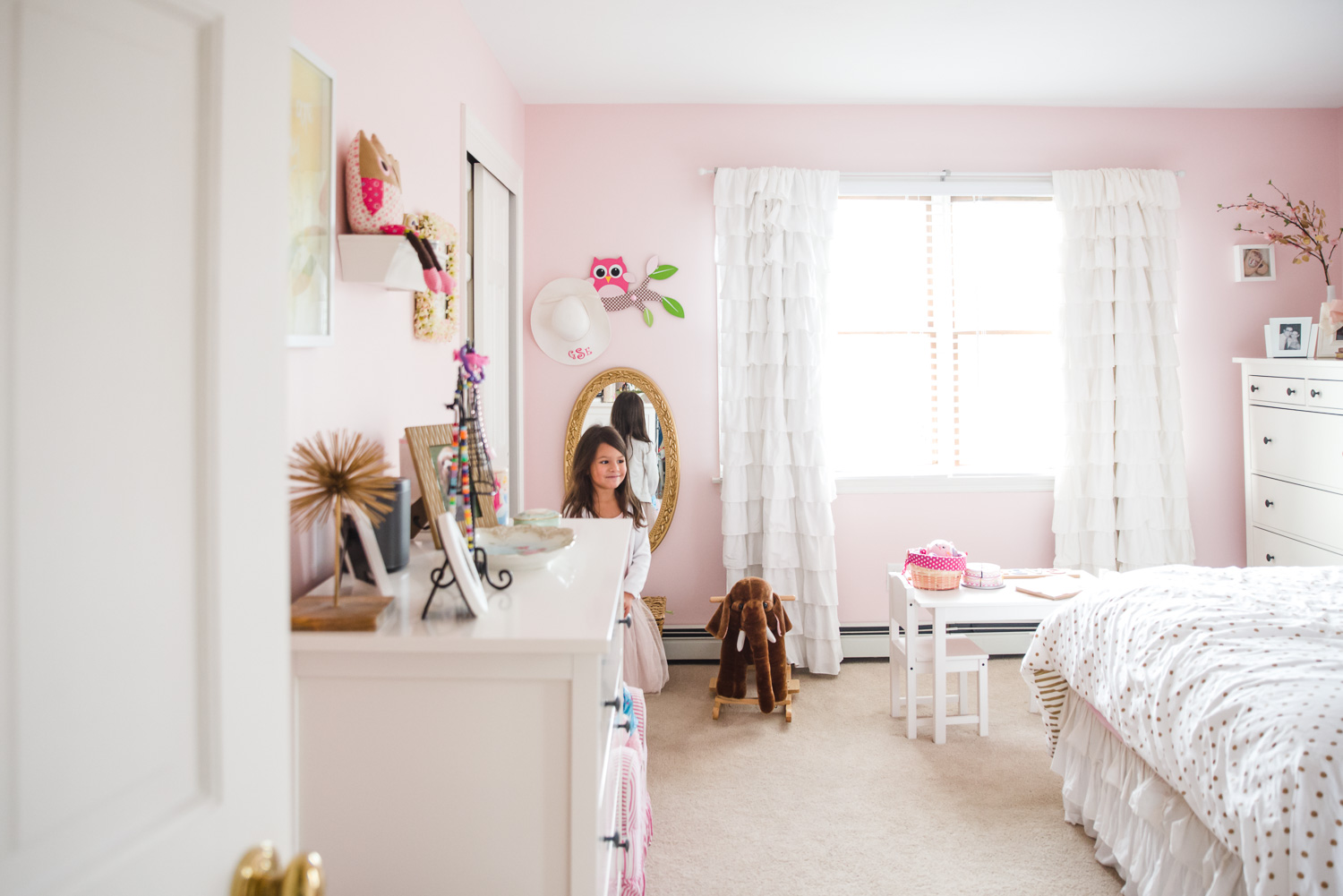 A little girl in her pink girly bedroom.