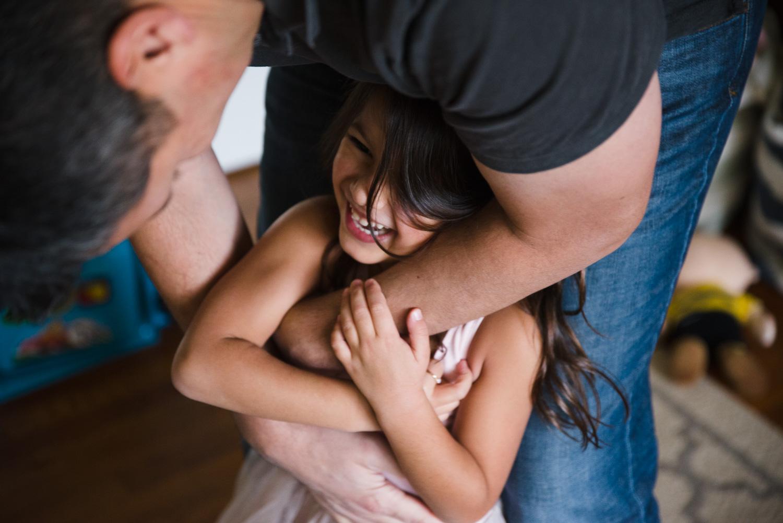 Dad embracing daughter.