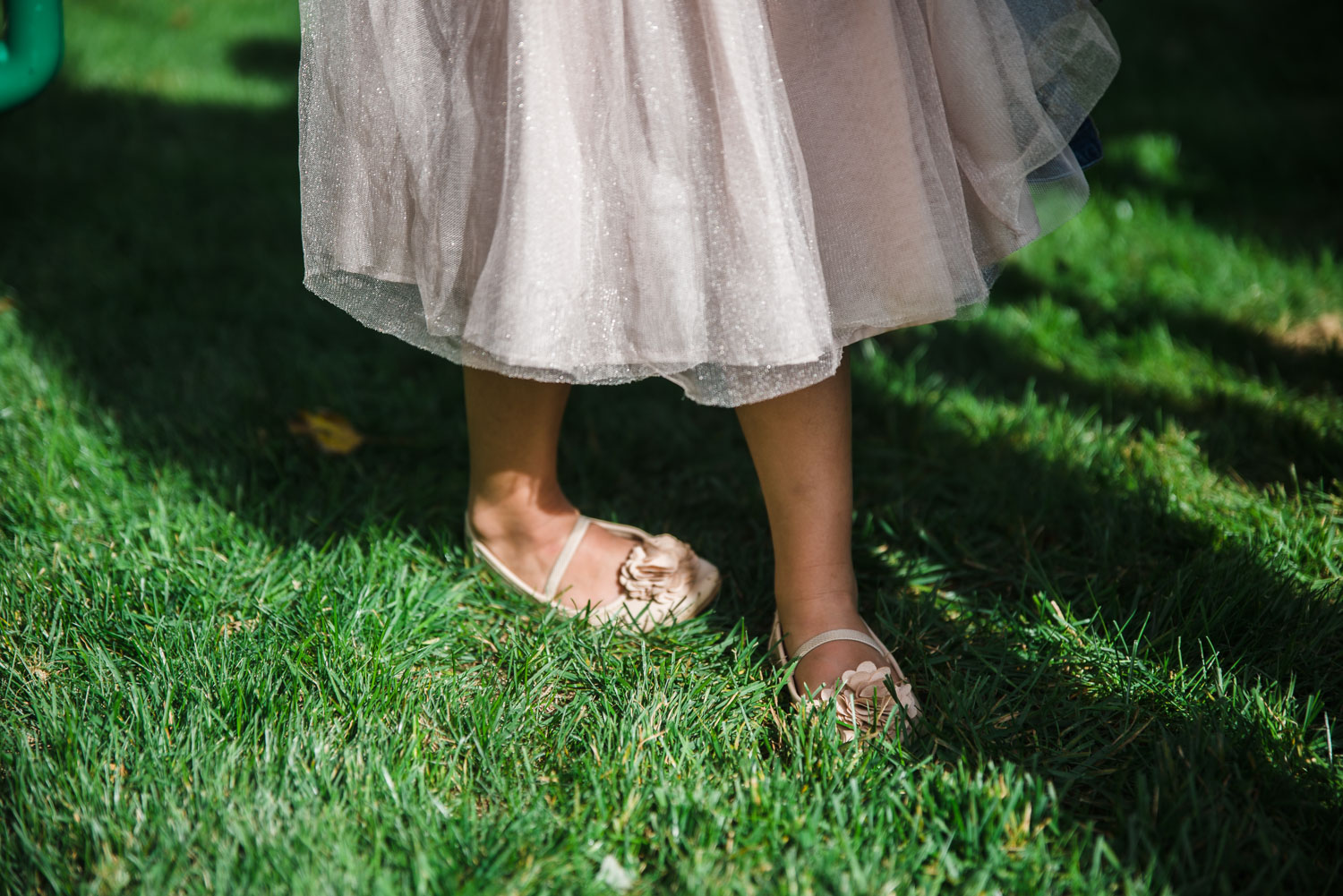 Little girl's pink skirt and shoes.