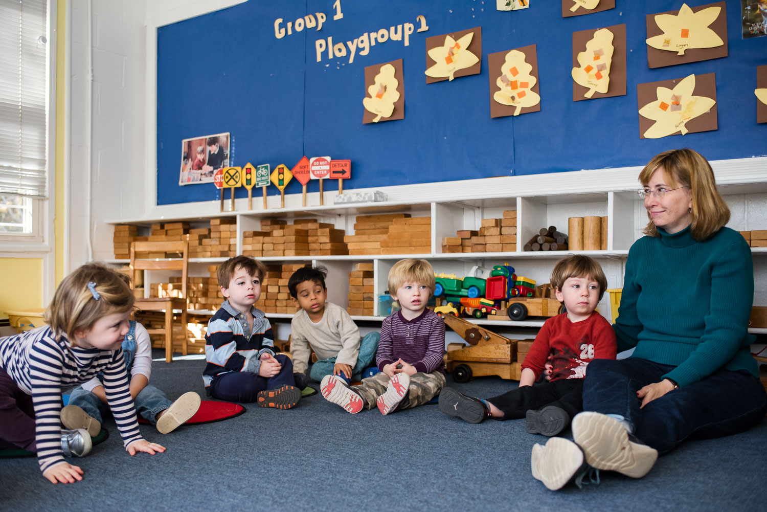 Kids gathered for story time at nursery school.