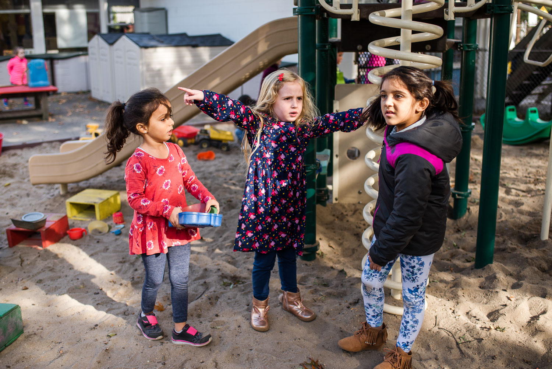 Little girls talking on the playground.