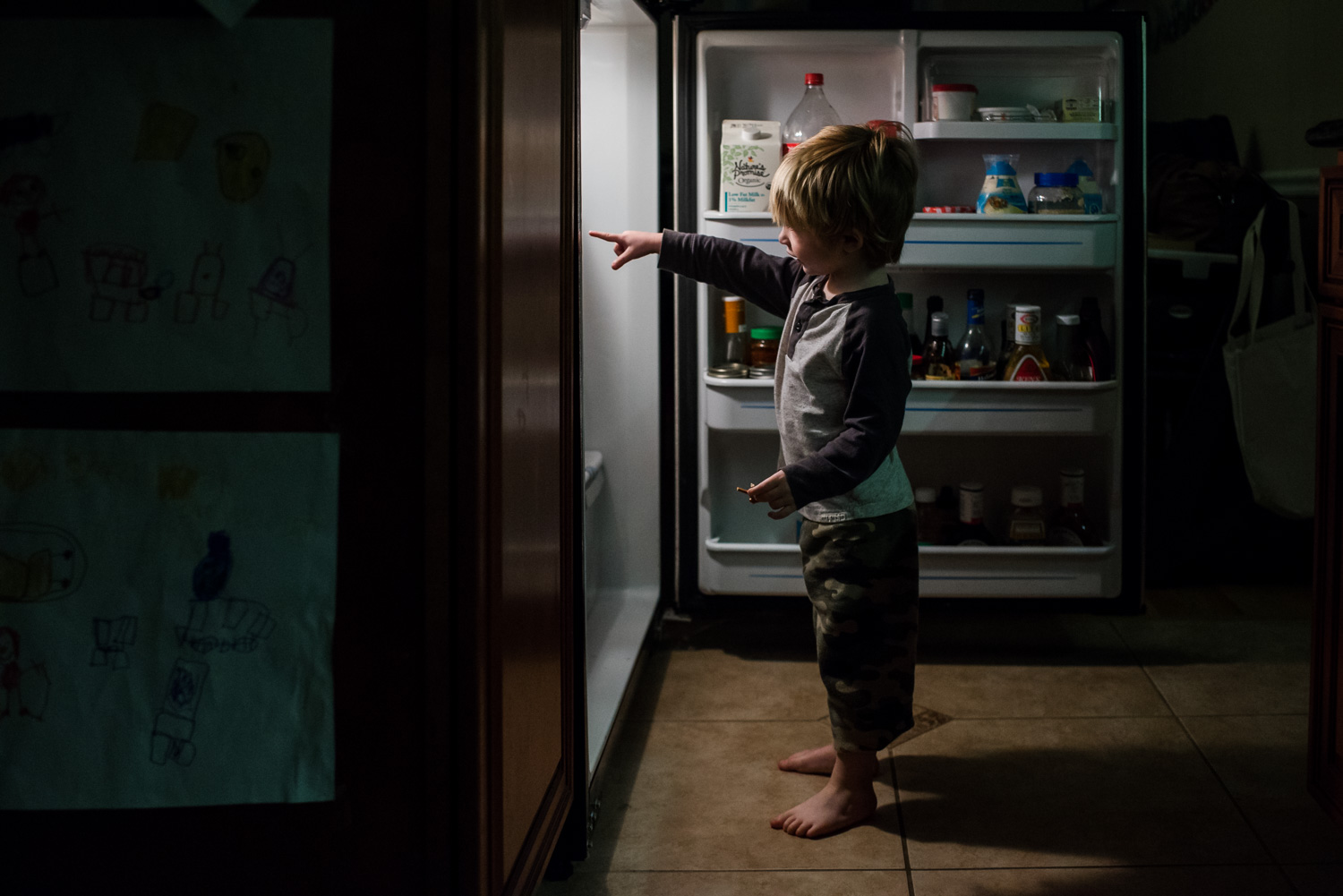 Little boy looking in the refrigerator