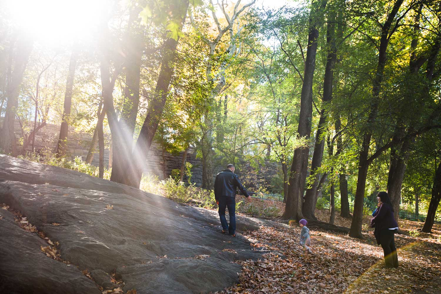 Family climbing a hill in beautiful light at Riverside Park.