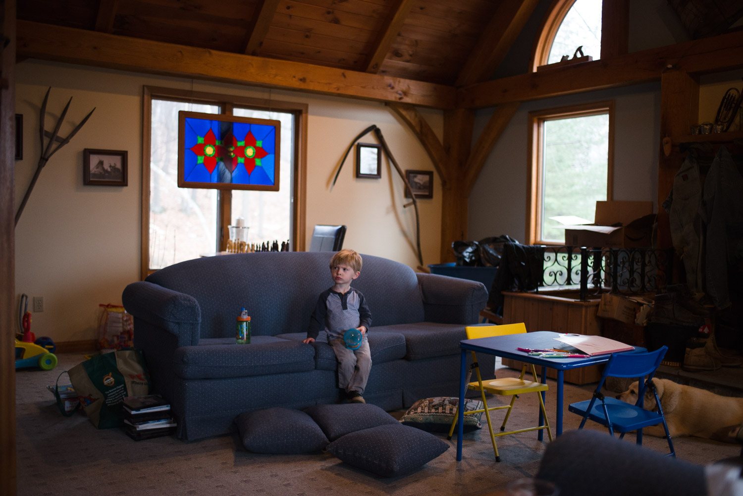 Little boy sitting on couch watching TV.