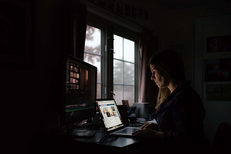Woman editing at her computer.