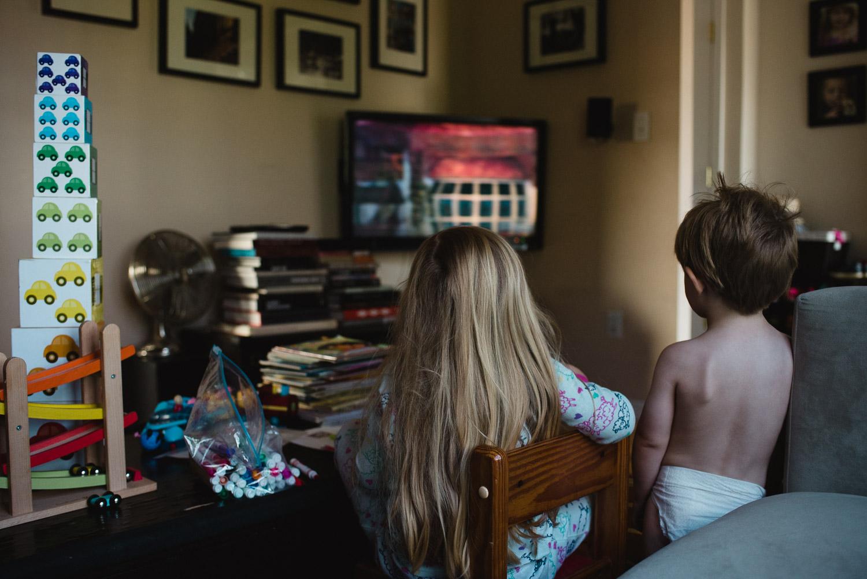 Kids watching TV.