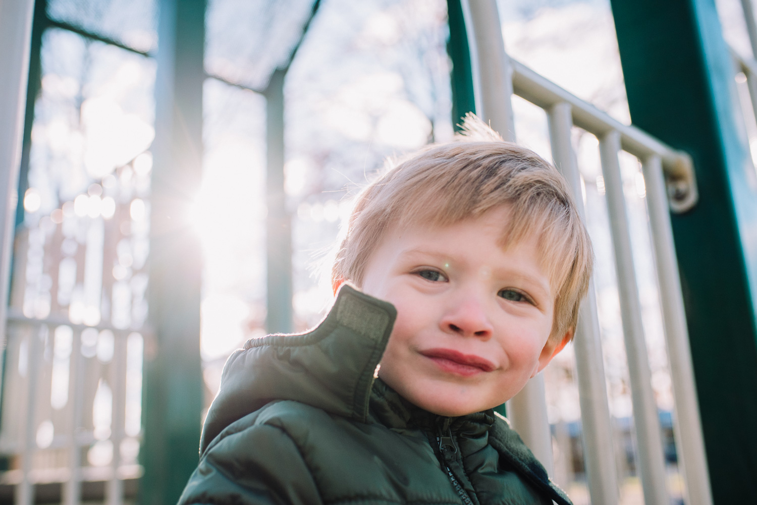 Portrait of a boy on the playground on a cold day.