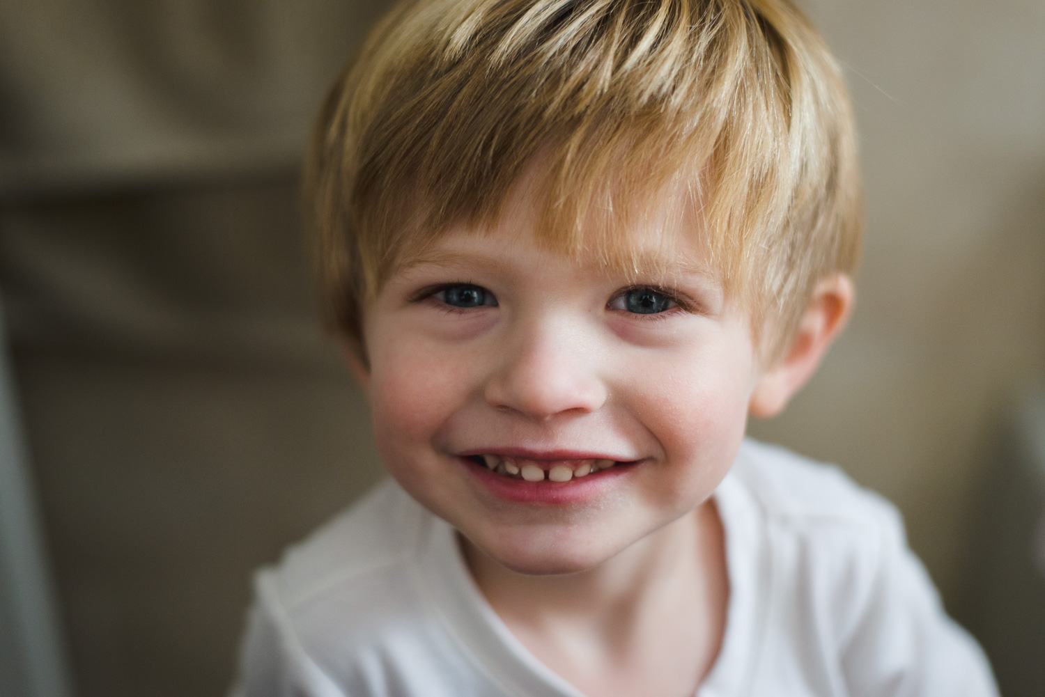 Portrait of a little boy with blonde hair.