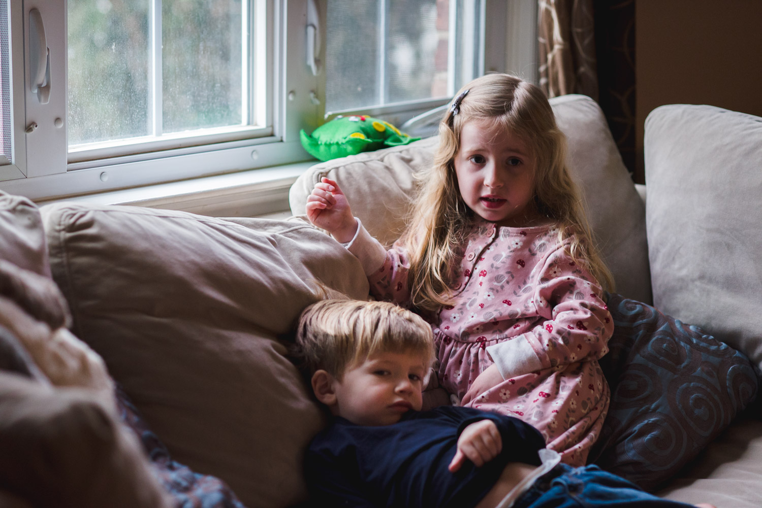 Children lounging on the living room couch.