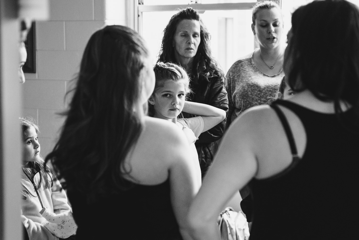 Dancers huddle in the hallway at Trinity High School in Hicksville.