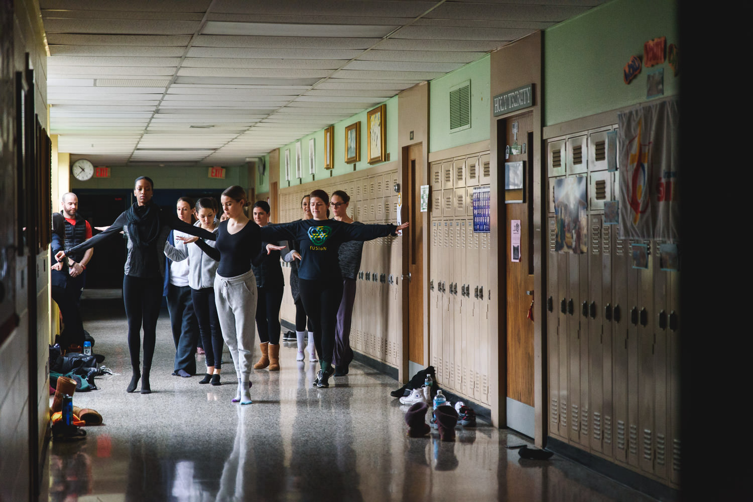 Dancers rehearsing in the hallway at Trinity High School in Hicksville.