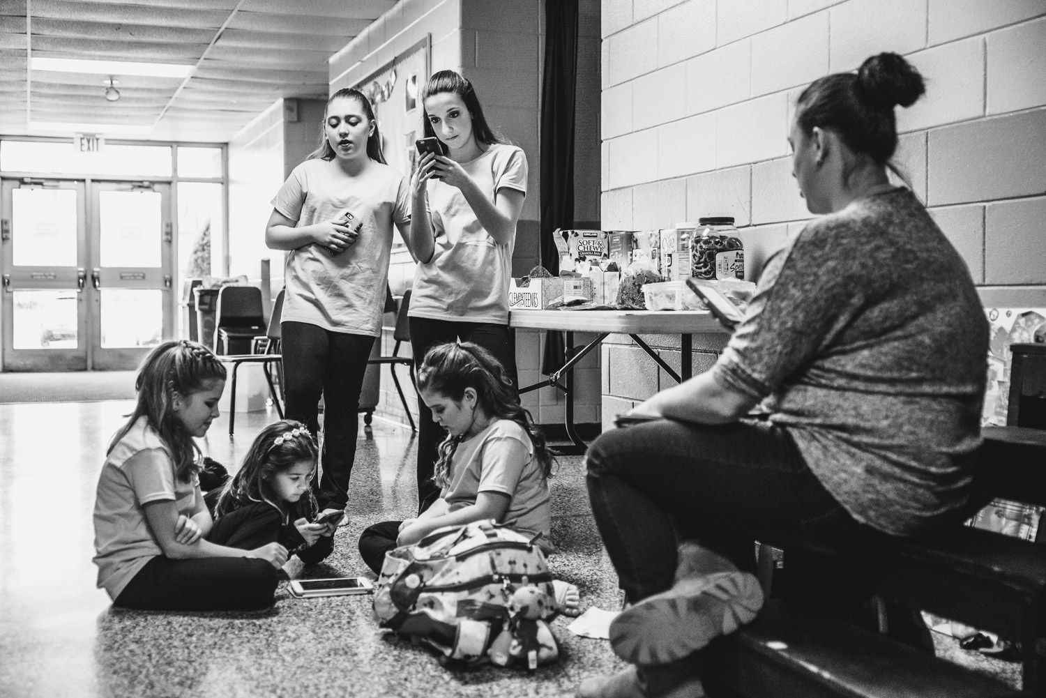 Young dancers snack before a rehearsal at Trinity High School in Hicksville.