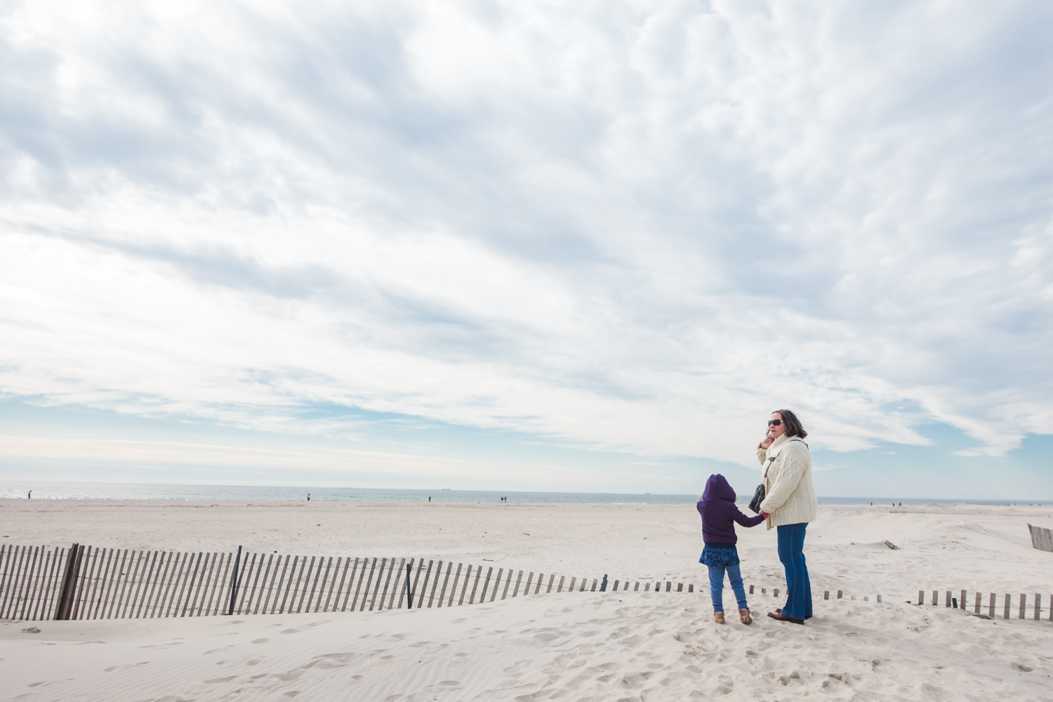 Grandmother and granddaughter on the sand at Jones Beach.
