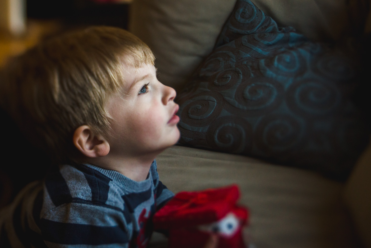 Portrait of a little boy lying on the couch.