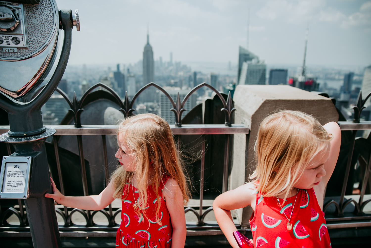 Two little girls look bored at Top of the Rock.