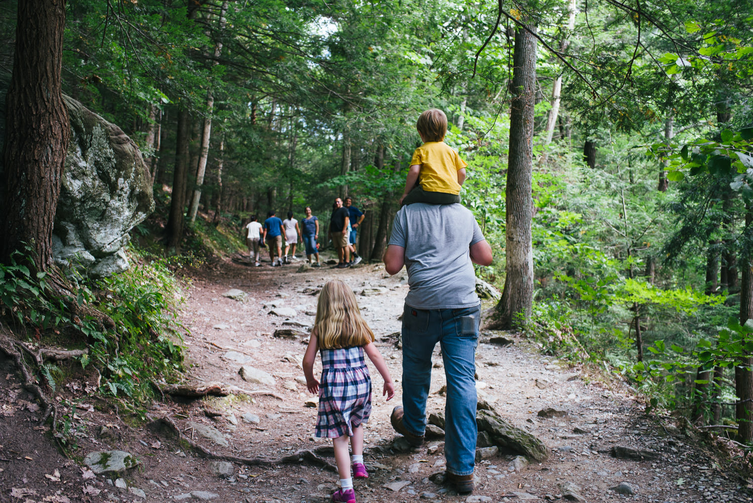 A father walks the trail to Bash Bish Falls with his two young kids.