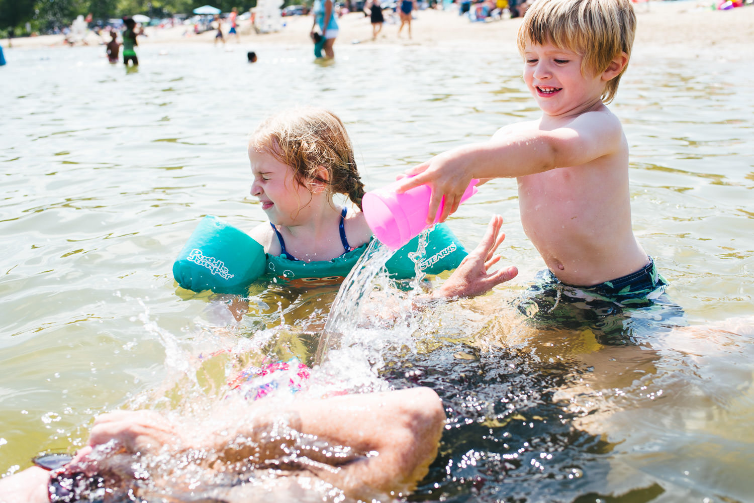 Two kids dump water on their grandmother at Lake Taghkanic.