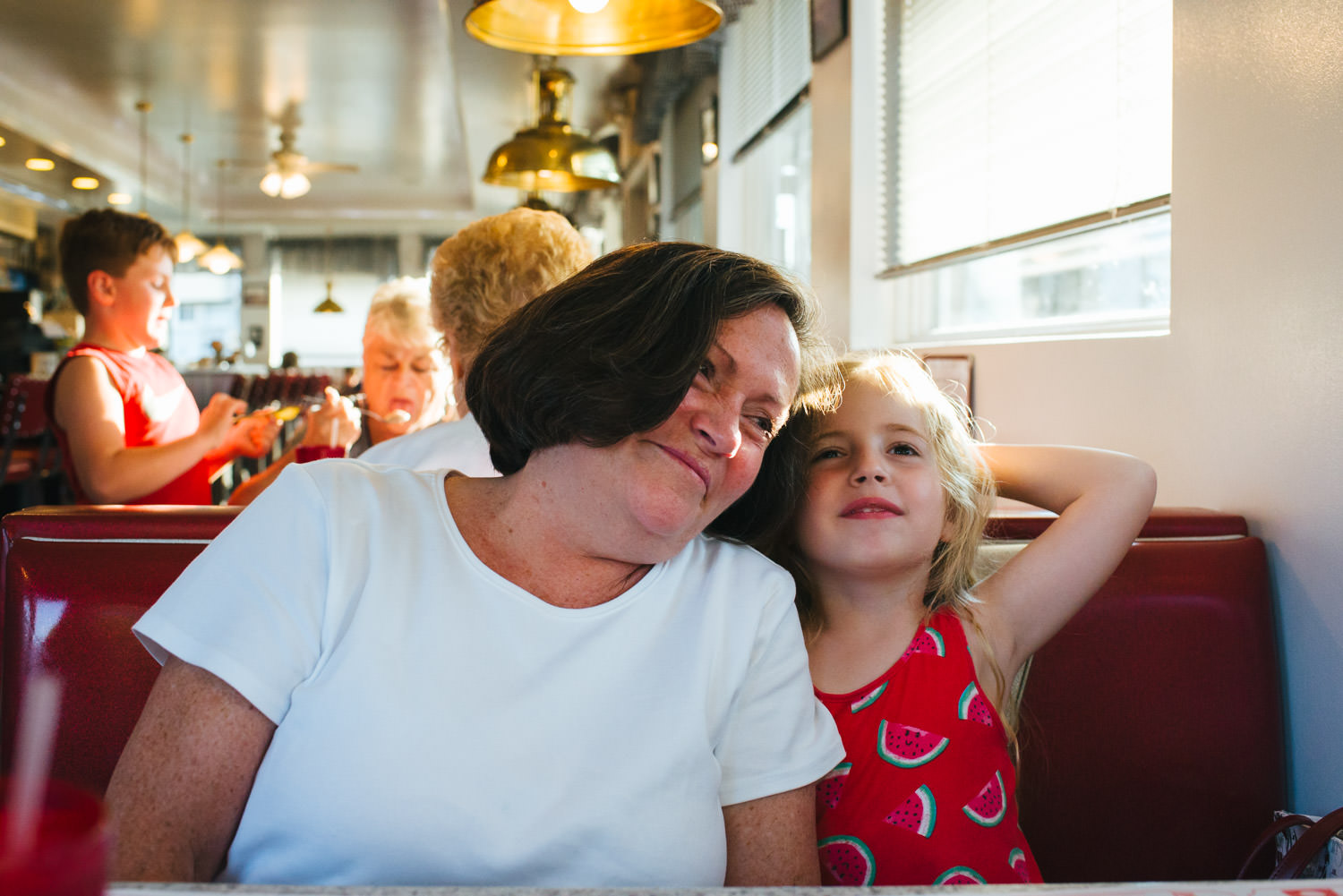 A grandmother and granddaughter eat dinner at Dad's Diner in Copake.