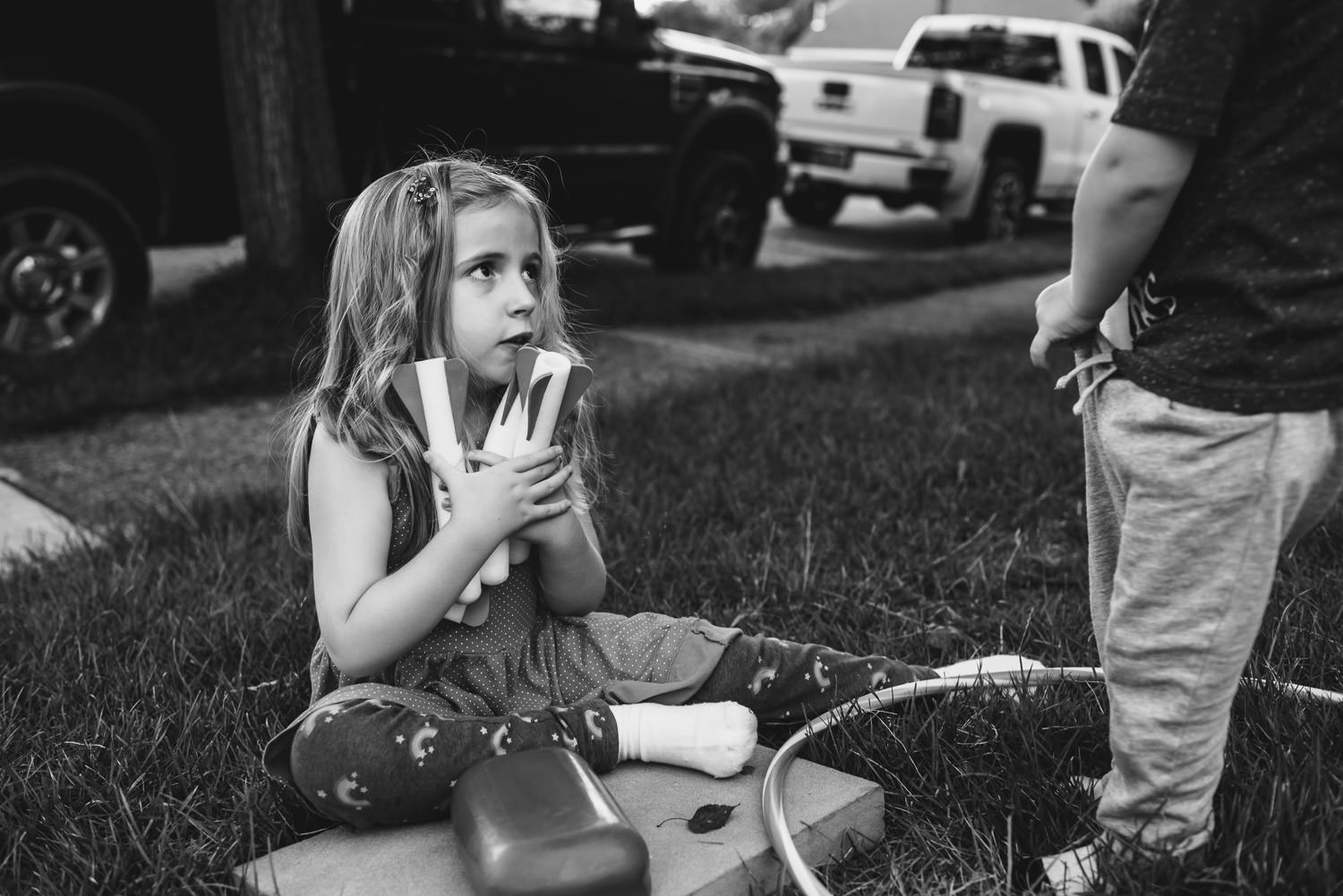 A little girl holds an armful of stomp rockets.