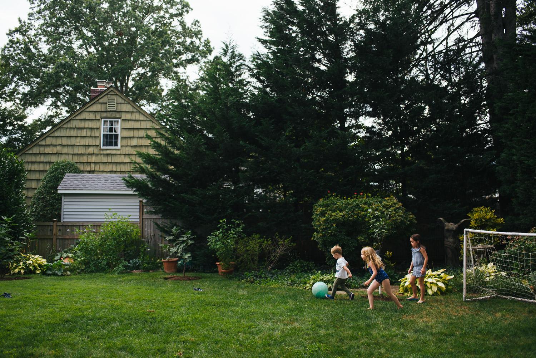 Kids play soccer in a backyard in Westbury.