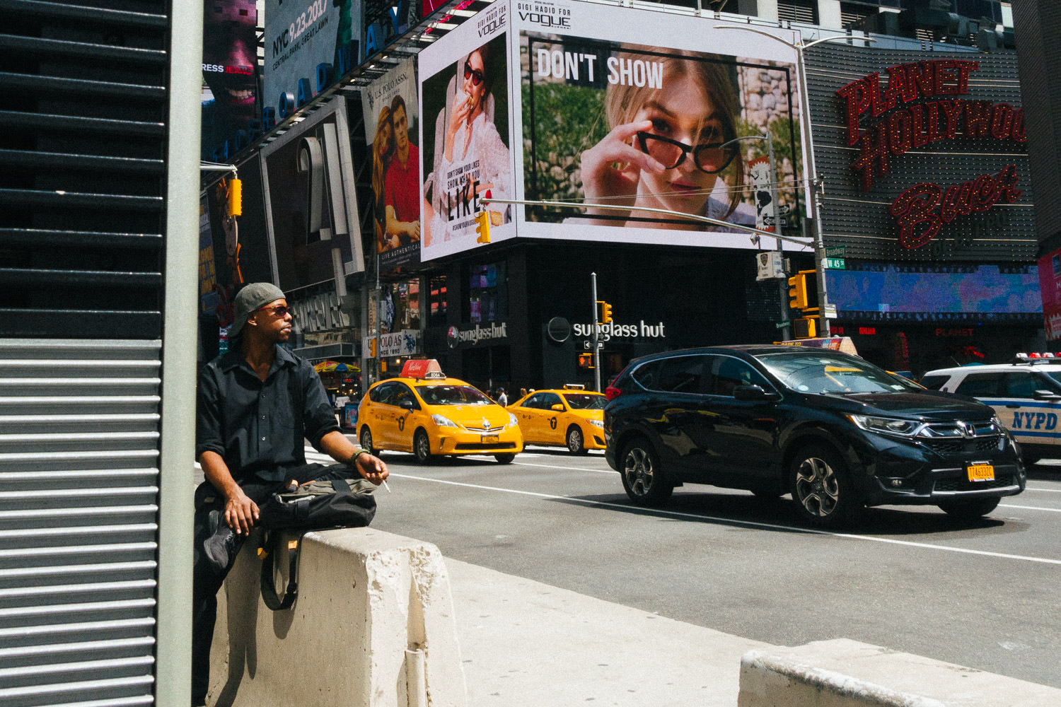 A man sits and takes in the sun in Times Square.