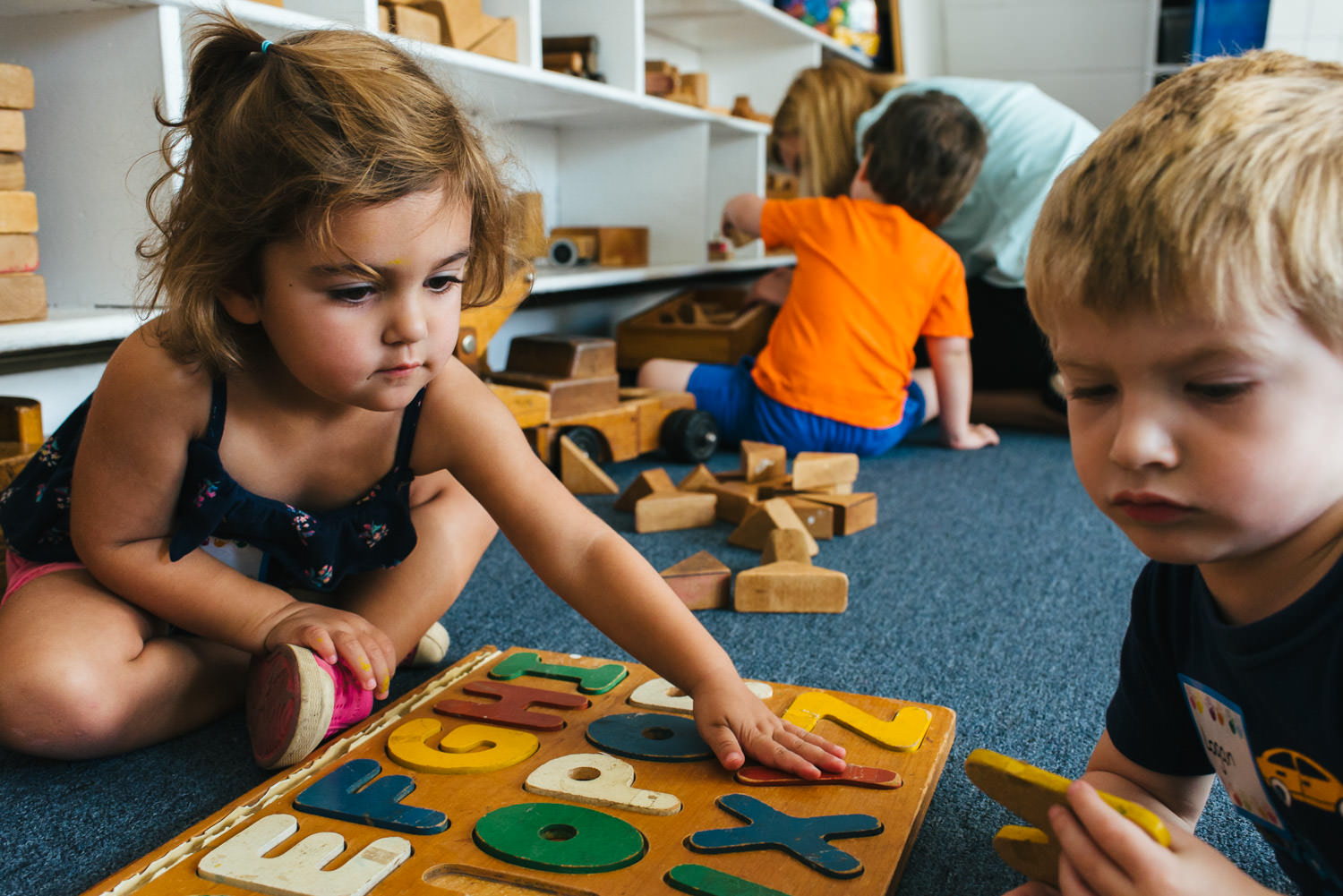 Children play with a puzzle at school.