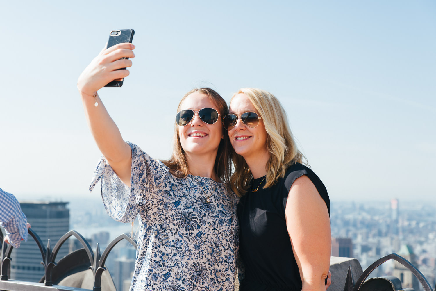 A mother and daughter take a selfie at Top of the Rock.