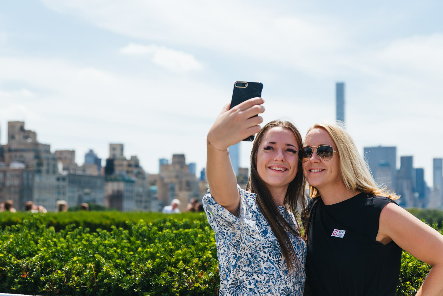 A mother and daughter take a selfie on the roof of the Met Museum.