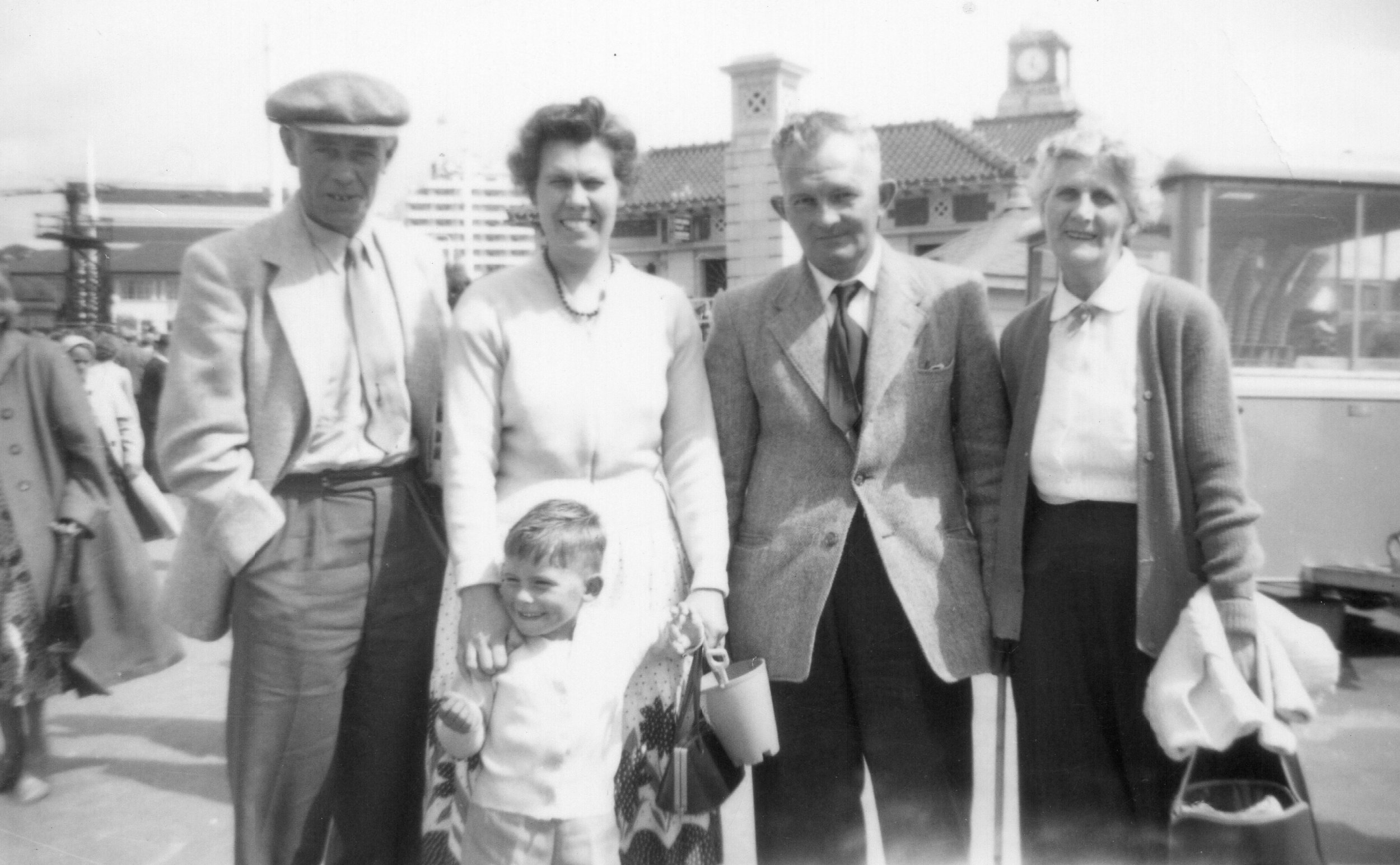 My dad with his parents and grandparents.