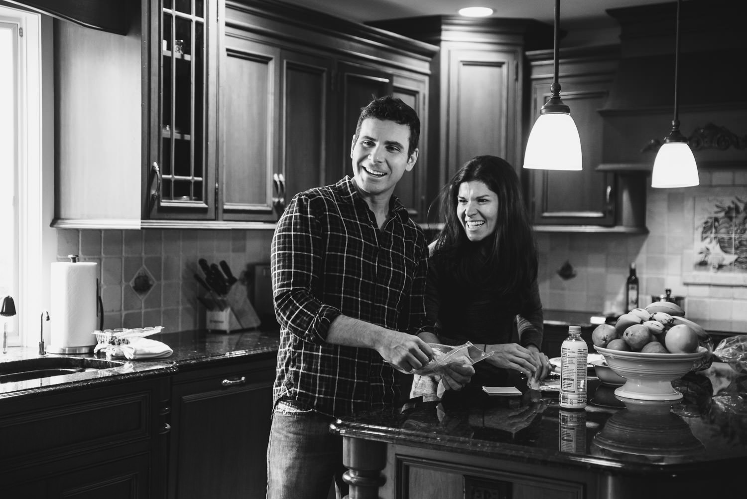 Parents smile in the kitchen.